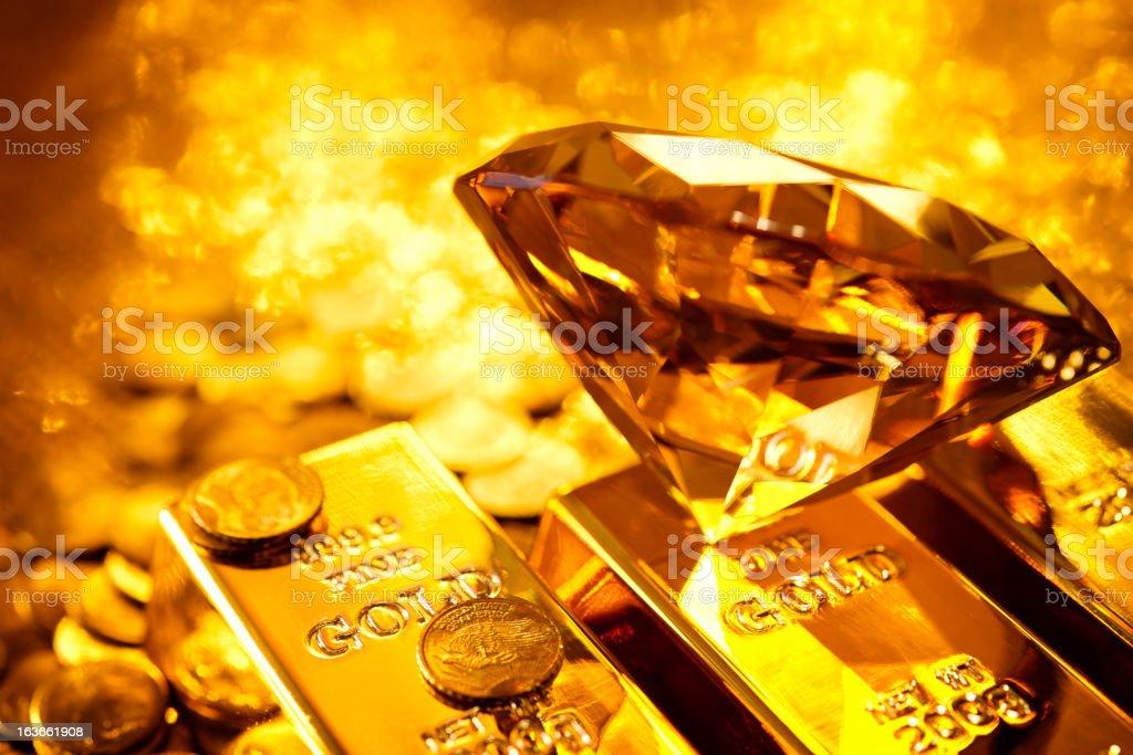 Amber diamond and gold assets stock photo