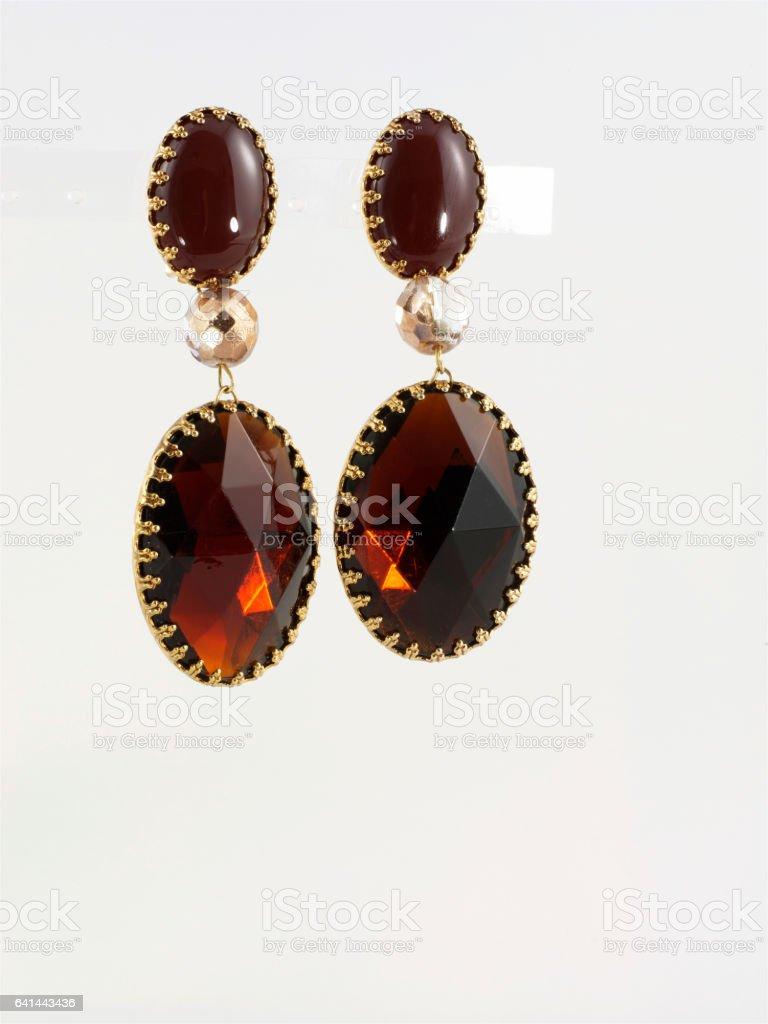 Amber earrings stock photo