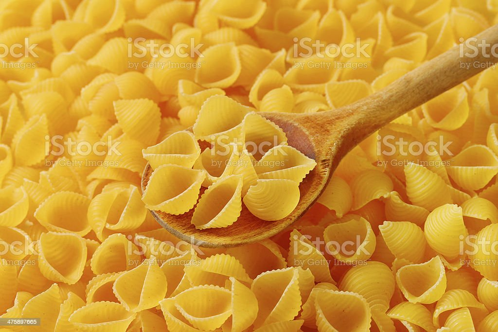 Amber texture of shell shape pasta royalty-free stock photo