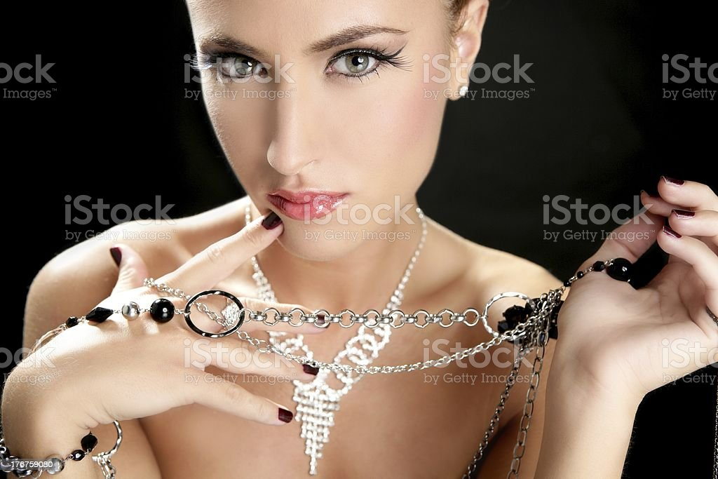 Ambition and greed in fashion woman with jewelry stock photo