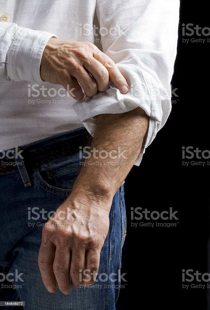 Ambition: Rolling up sleeve royalty-free stock photo