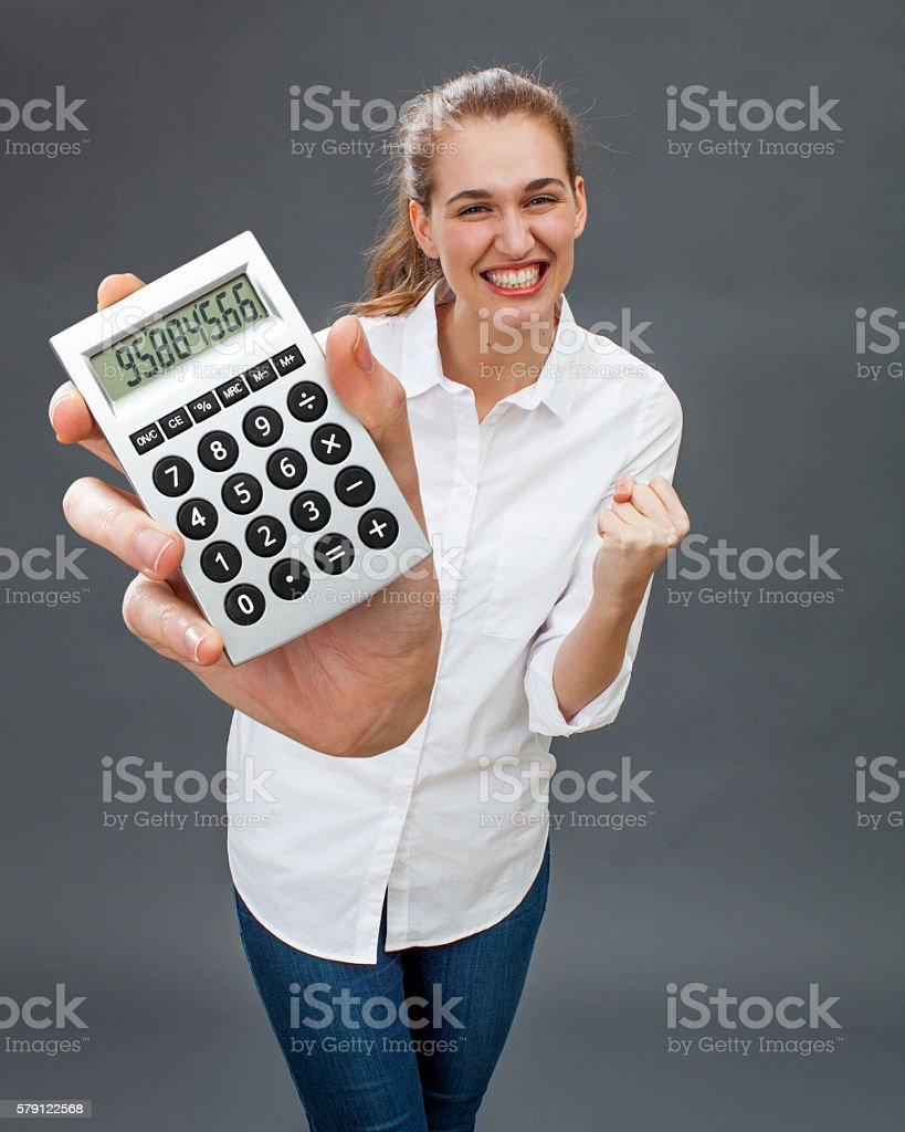 ambitious beautiful young woman smiling and acting victorious, winning jackpot stock photo