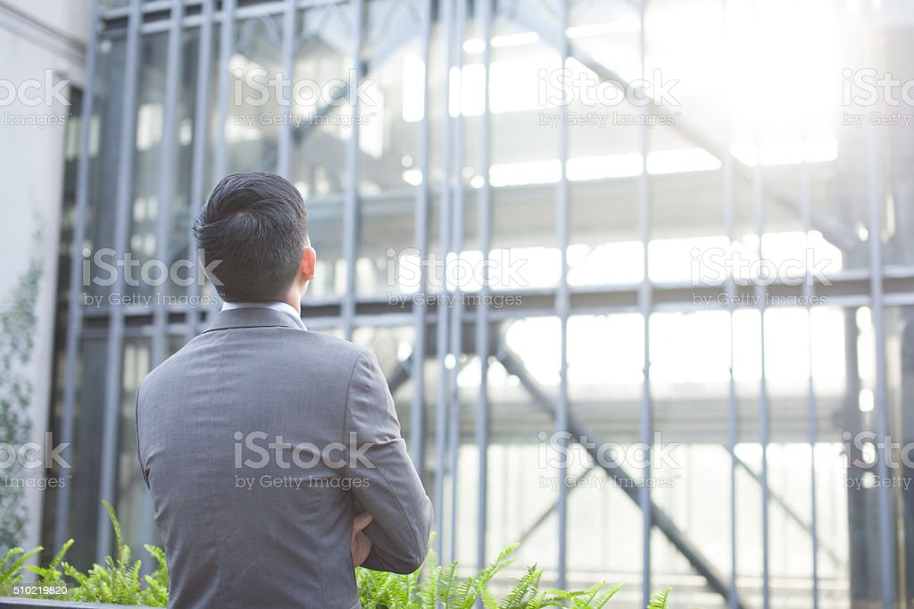 Ambitious business man from the back stock photo