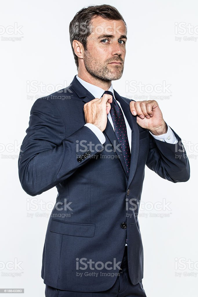 ambitious businessman expressing pride, power, success with attitude and superiority stock photo