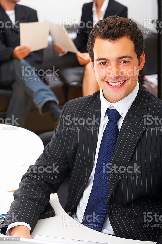 Ambitious businessman smiling royalty-free stock photo
