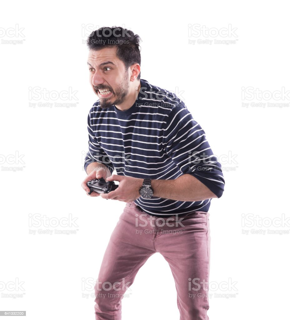 Ambitious young man with a joystick for game console stock photo