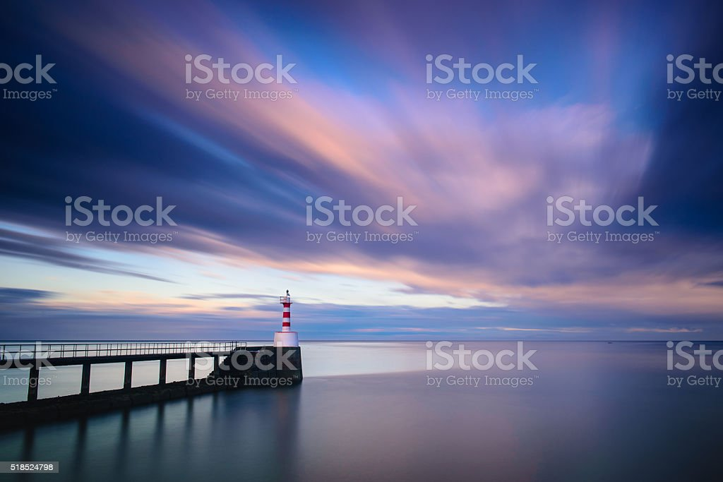 Amble pier and lighthouse at sunset long exposure stock photo