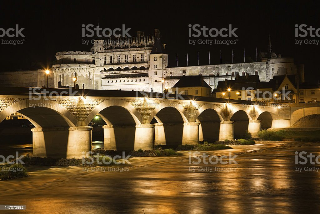 Amboise Chateau and old bridge at night stock photo