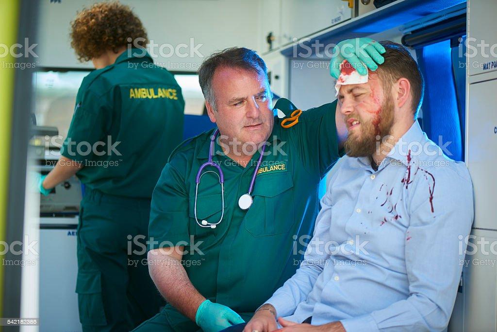 ambulance crew with drunk stock photo