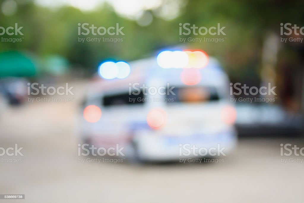 ambulance driving down road stock photo