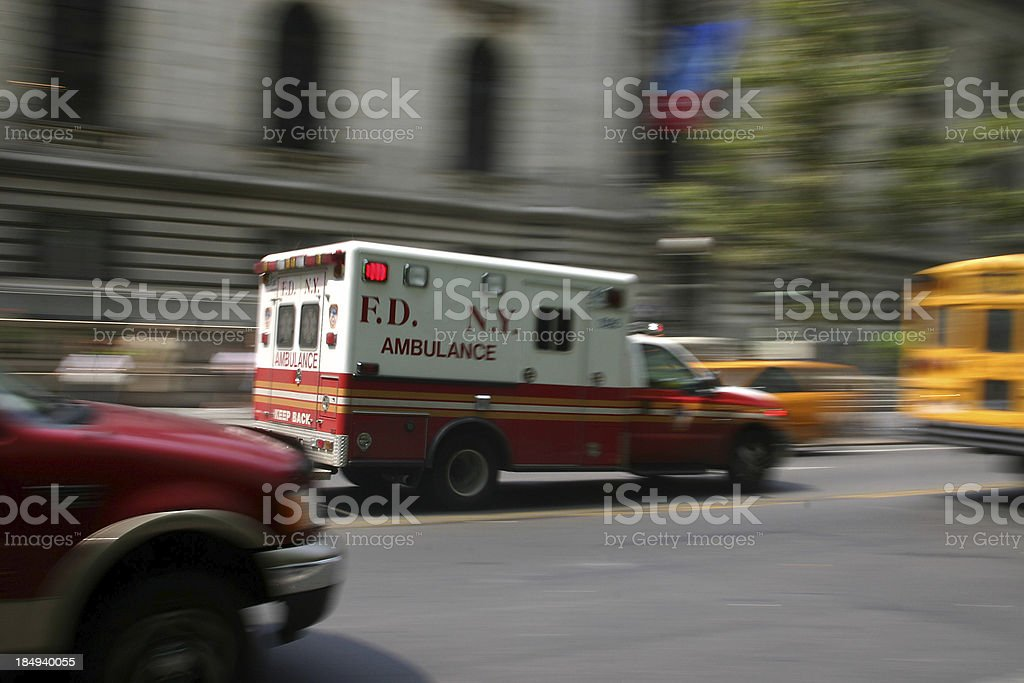 Ambulance driving fast in NYC stock photo
