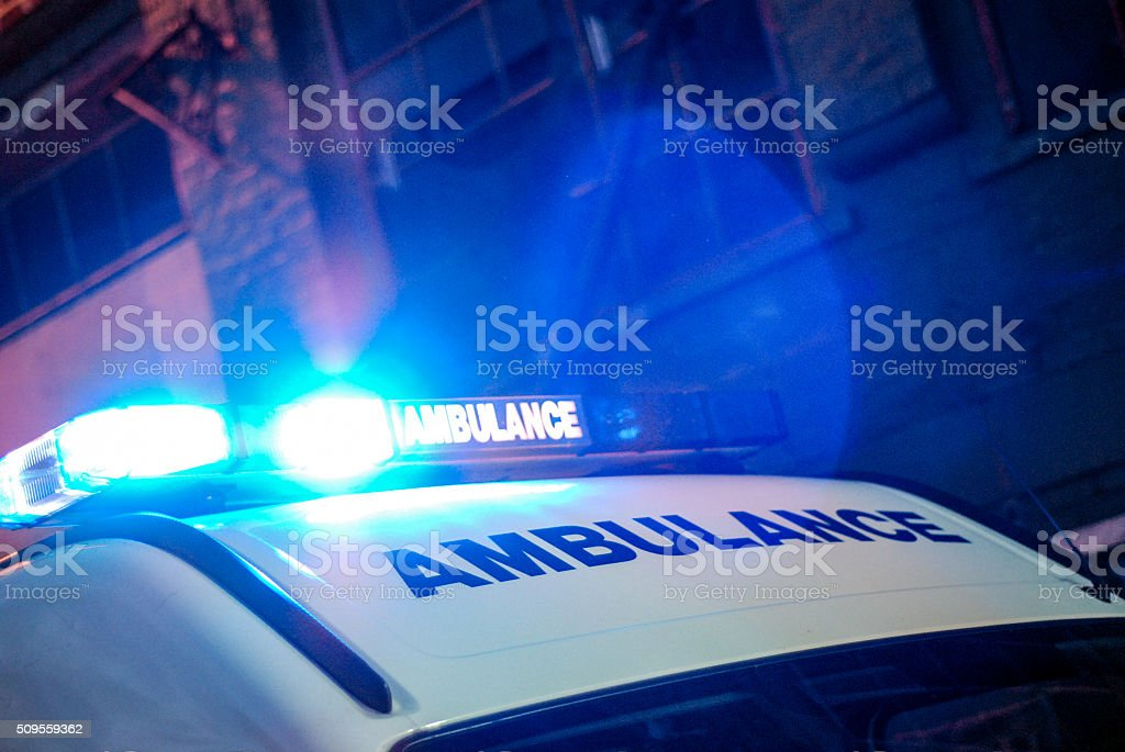 Ambulance in the street at night stock photo
