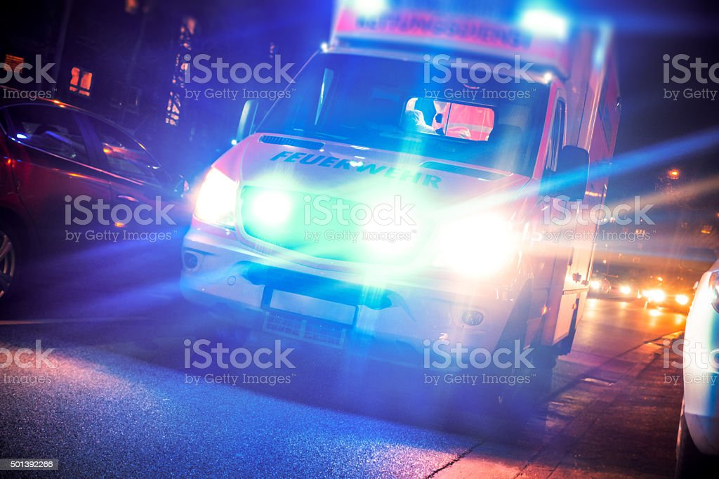 Ambulance in traffic stock photo