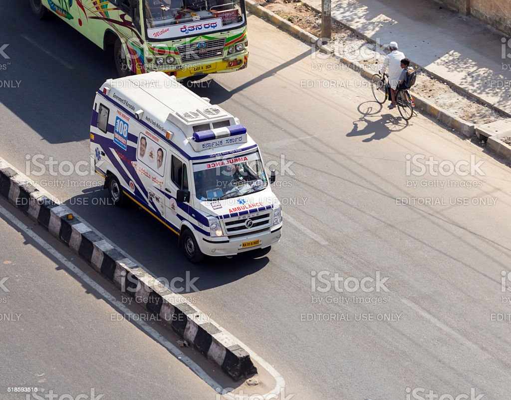 Ambulance on Bangalore street, India stock photo