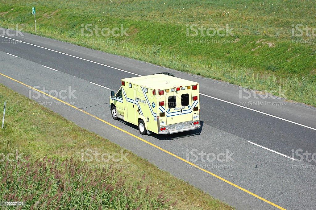 ambulance on highway royalty-free stock photo