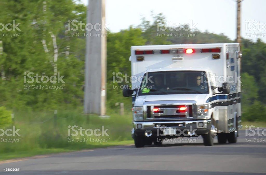 Ambulance Speeding With Sirens On. stock photo