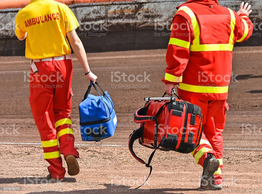 Ambulance stuff on the sport track stock photo