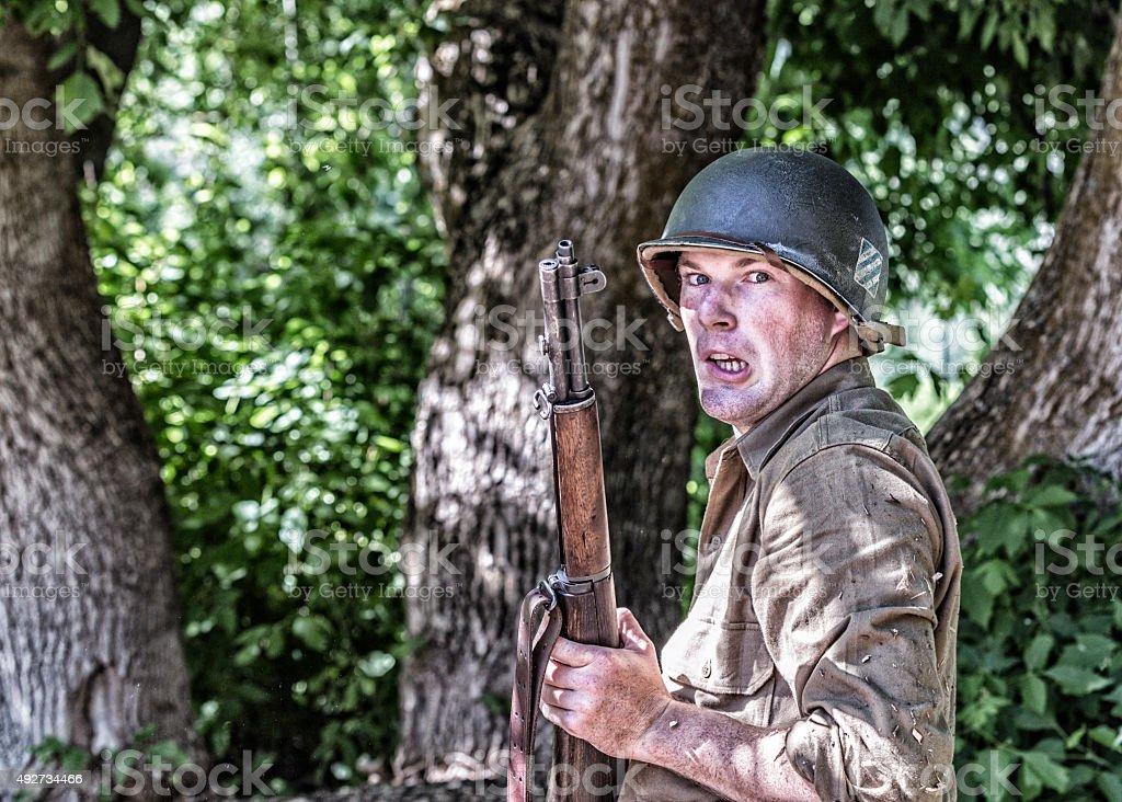 Ambushed World War II US Army Infantry Combat Soldier stock photo