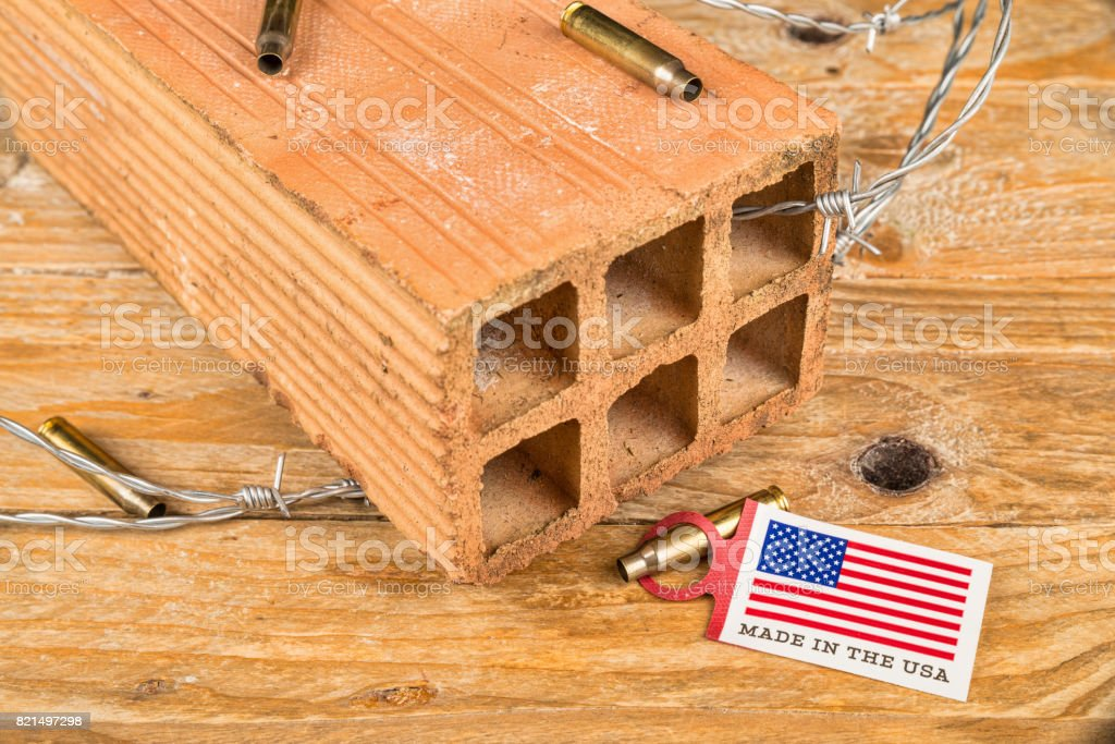 America concept with brick and barbed wire stock photo