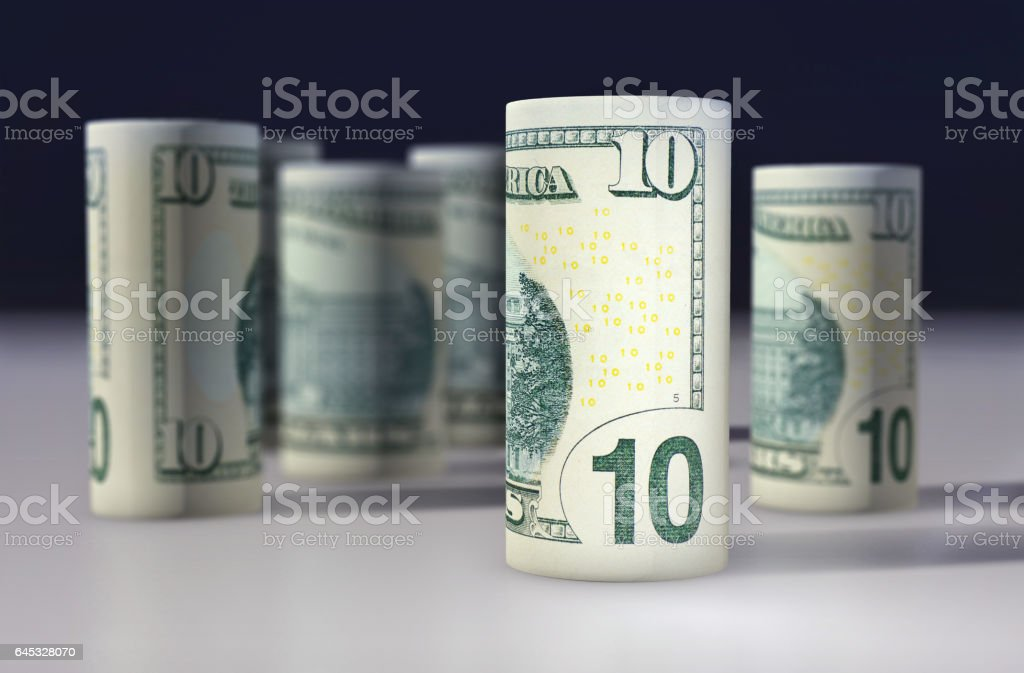 American 10 dollars greenback rolled up on the black stock photo