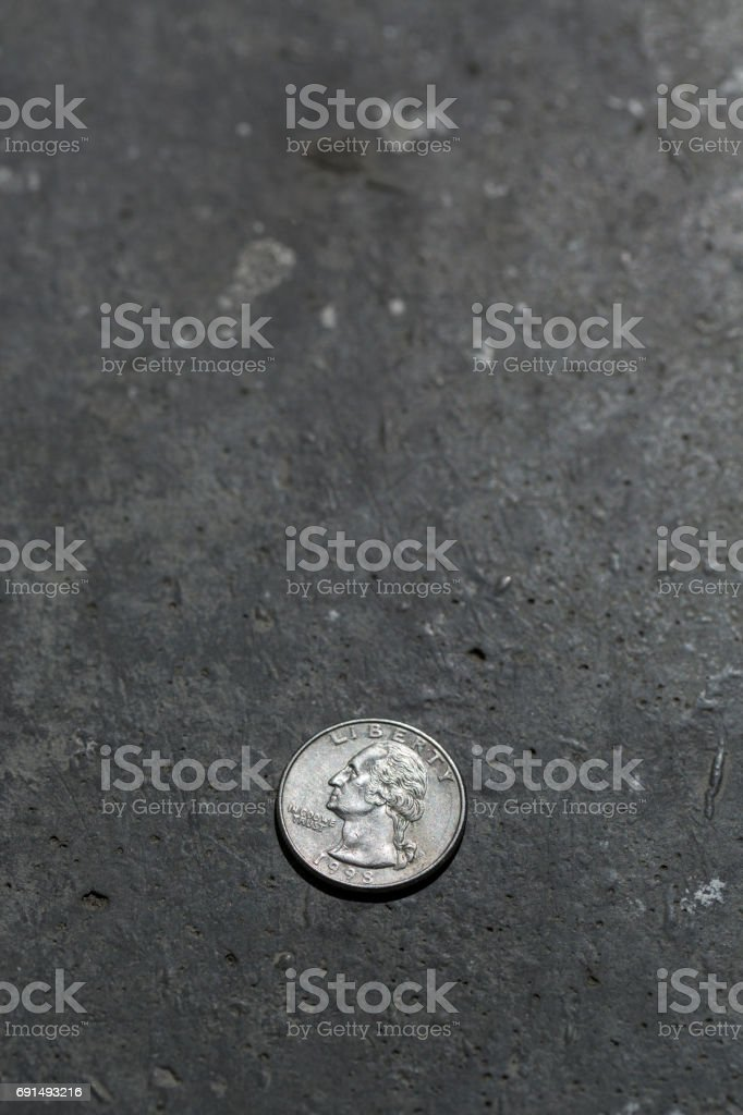American 25 cents coin on the floor. stock photo