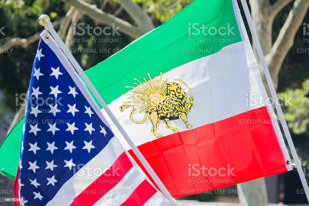 American and Iranian flags stock photo