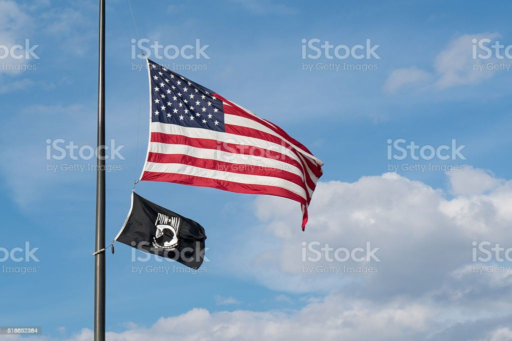 American and POW/MIA Flags stock photo