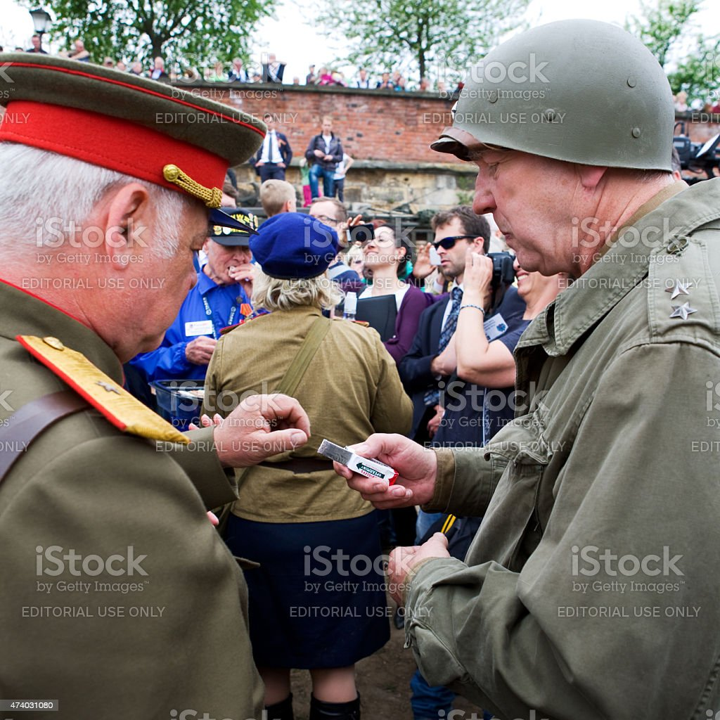 american and russian general sharing chewing gum on Elbe day stock photo