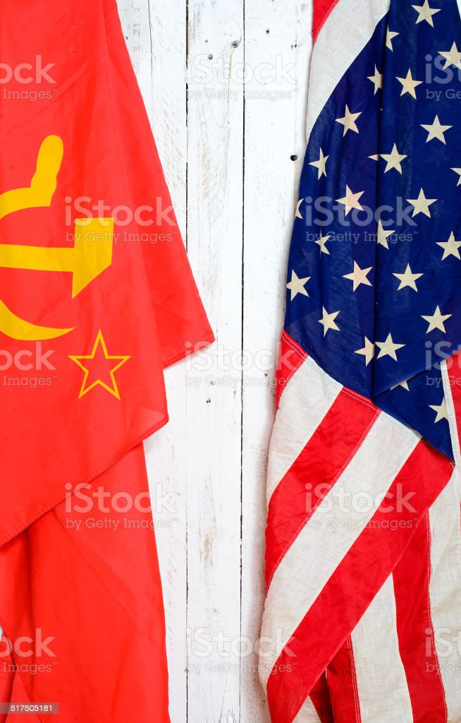 American and Soviet flag on a wall stock photo