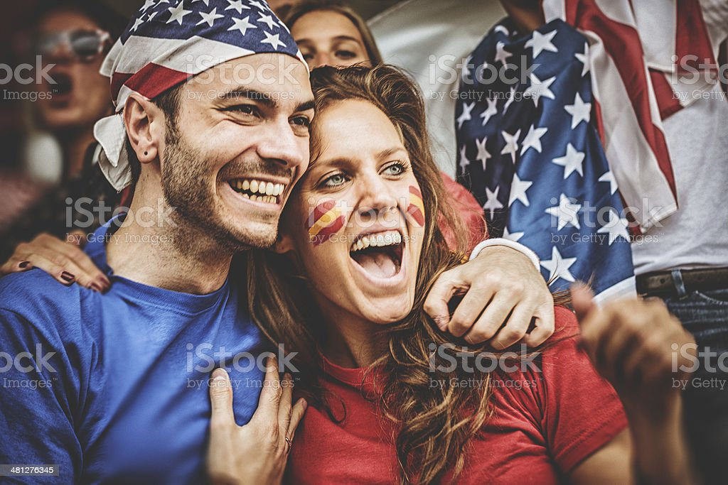 american and spanish supporter at the soccer stadium stock photo