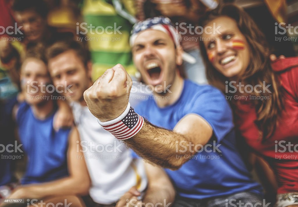 american and spanish supporter at the soccer stadium royalty-free stock photo
