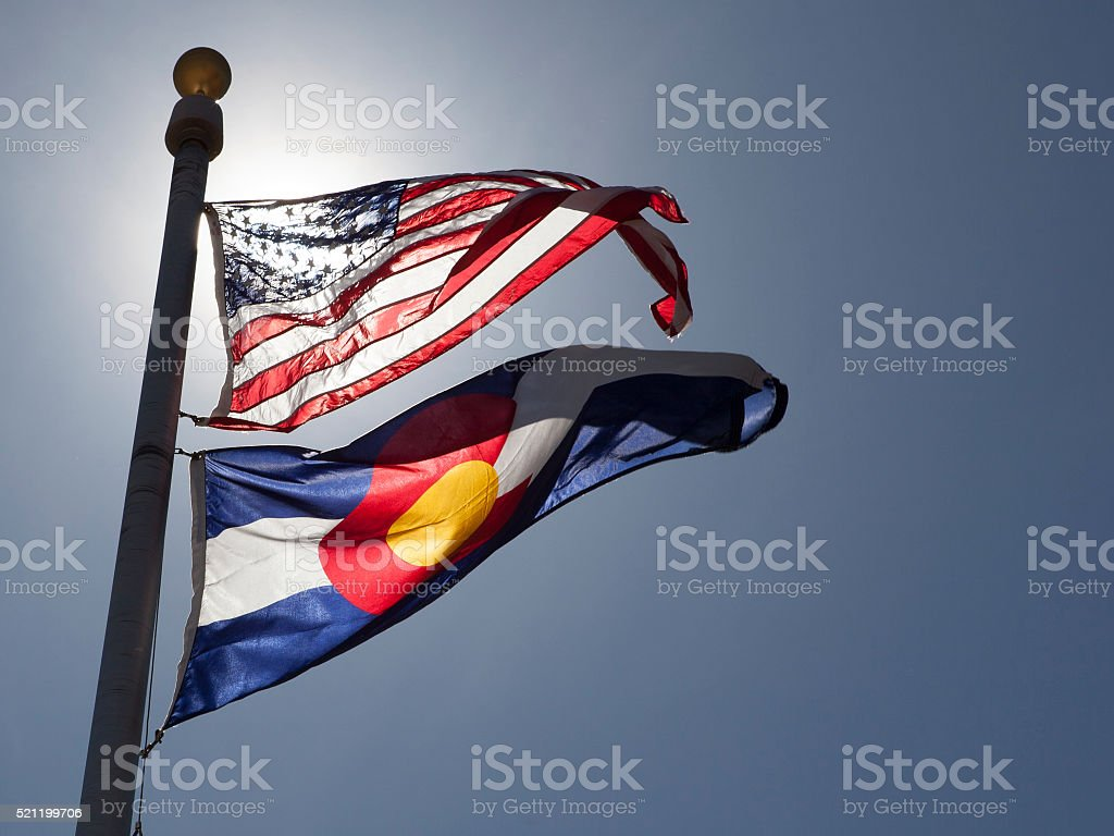 American and State of Colorado flags stock photo