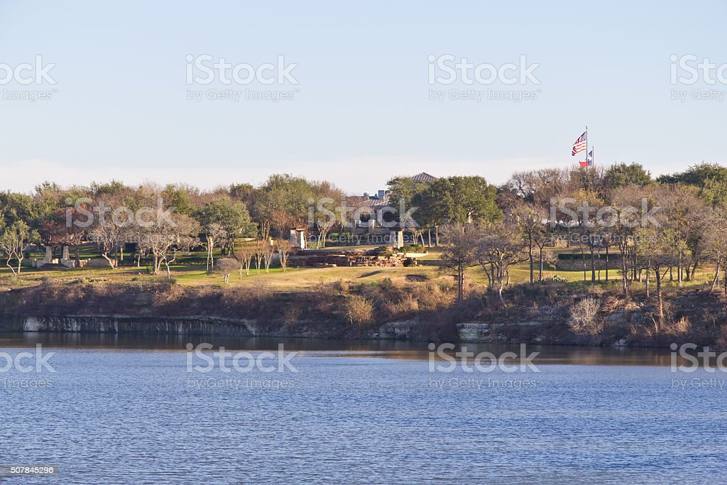 American and Texas flags on sunset at Brushy Creek Regional stock photo