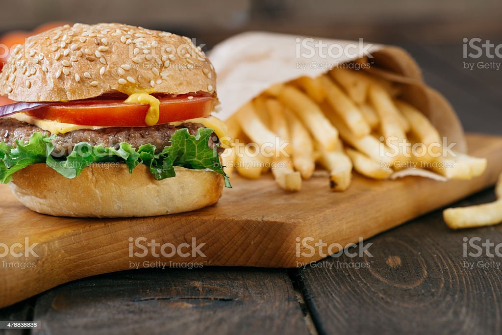 Close -up photo ,american beef burgers with cheese on the wooden...