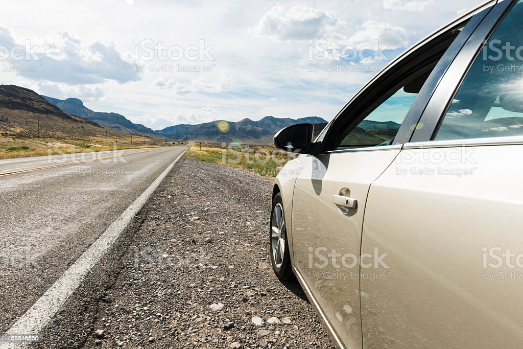 American Car Parked Along Rural Highway During Scenic Road Trip stock photo