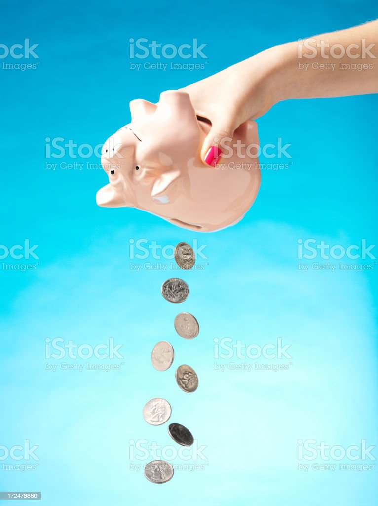 American Cents Falling from a Coin Piggy Bank royalty-free stock photo