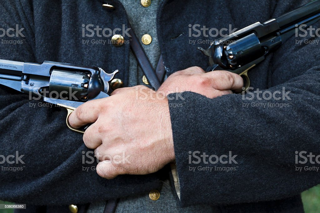 American Civil War Reenactor Holding Two Pistols stock photo