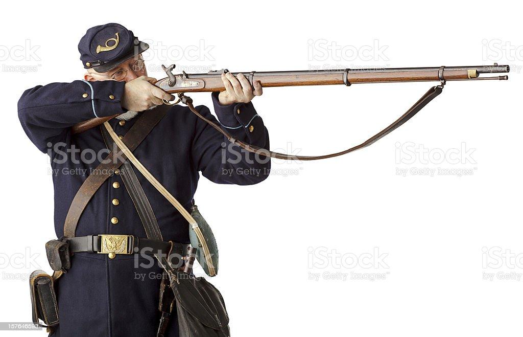 American Civil War Union Soldier Firing Rifle on white. stock photo