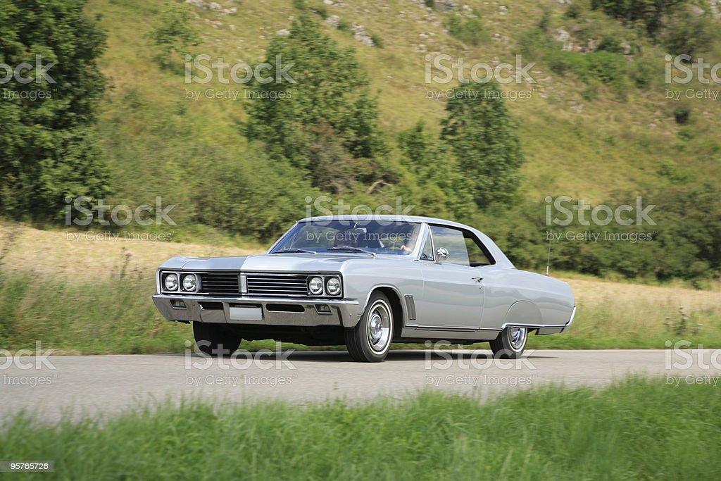 American Classic Car Driving  Through Nature Landscape stock photo