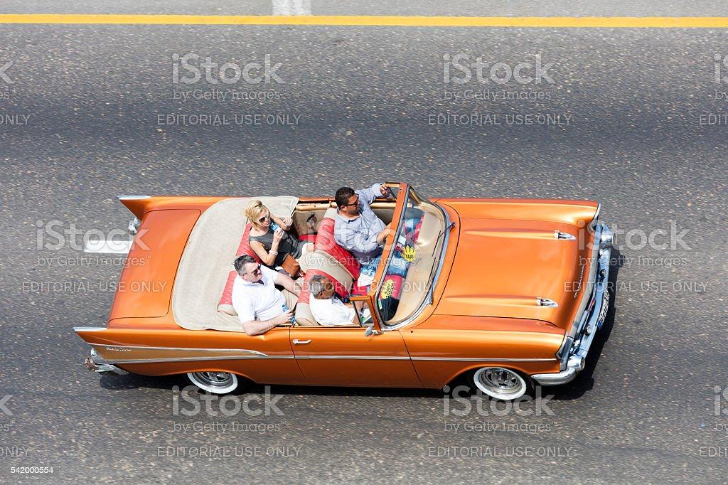 American Classic Car With Tourists, Malecon, Havana, Cuba stock photo