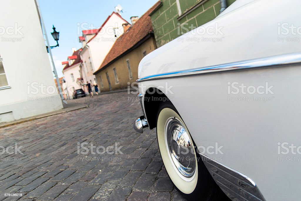 American classic white oldtimer in the old town streets stock photo