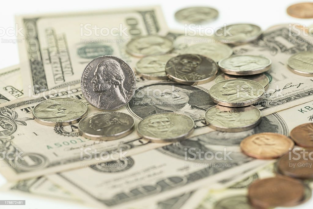 American coins scattered around on US banknotes royalty-free stock photo