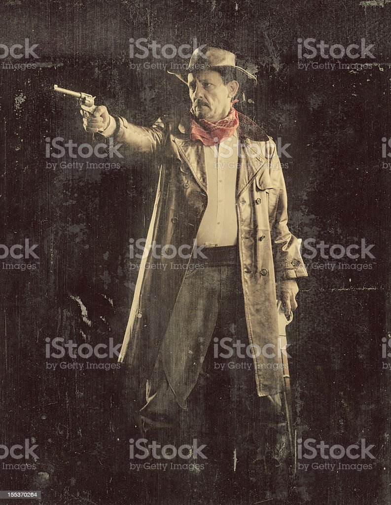 american cowboy aiming revolver stock photo