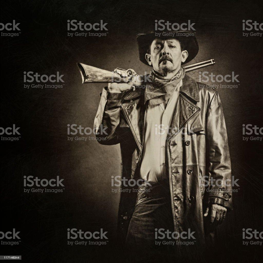 american cowboy with gun stock photo