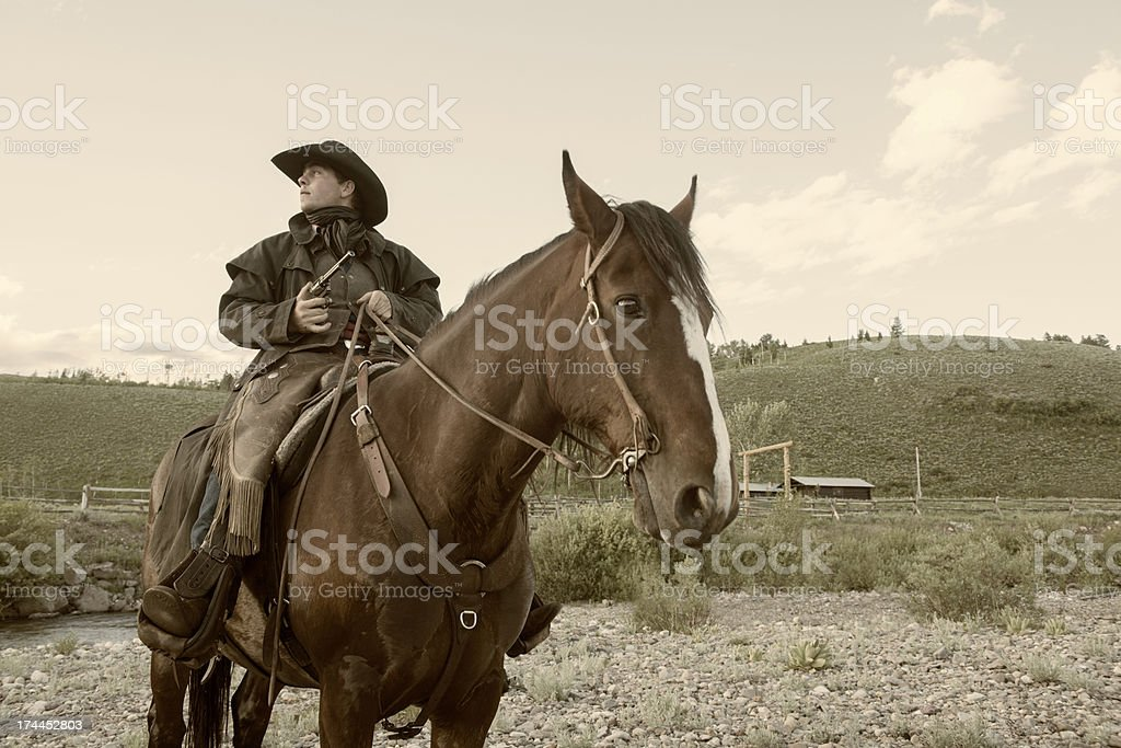 American Cowboy with Gun Wild West Outlaw on Horse stock photo