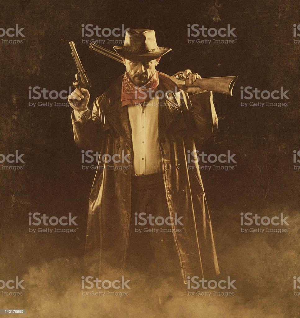 american cowboy with guns stock photo