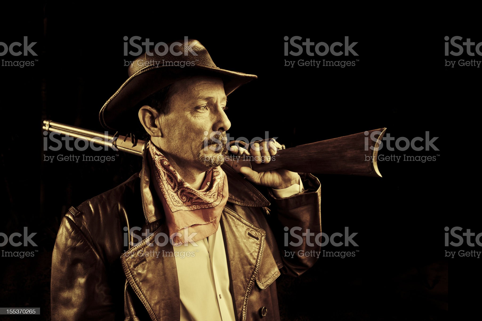 american cowboy with rifle royalty-free stock photo