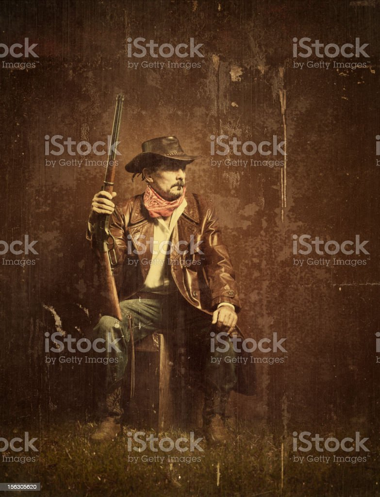 american cowboy with rifle stock photo