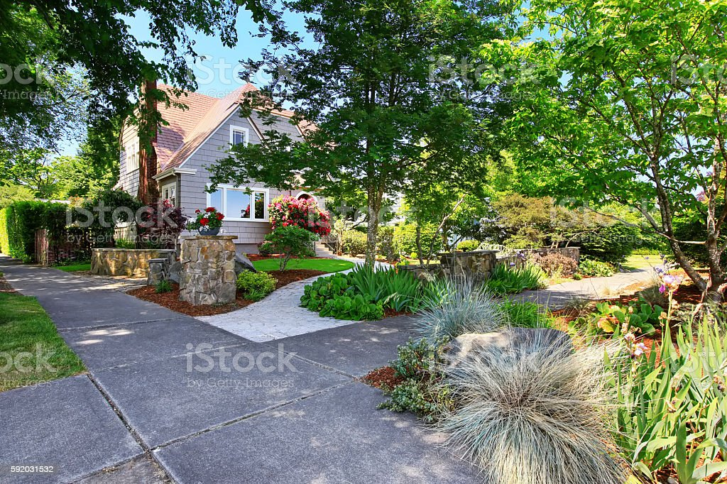 American craftsman house exterior. Nice landscape design around. stock photo