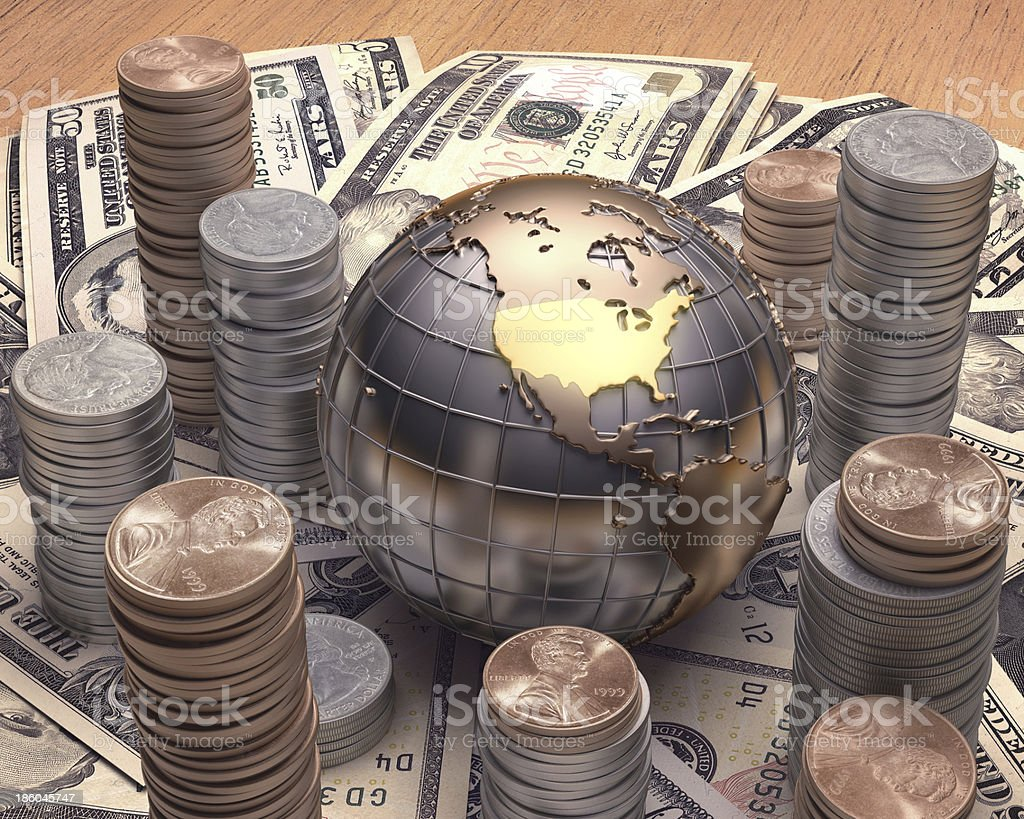 American currency surrounding a globe with gold continents stock photo